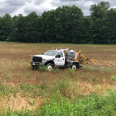 A white truck in a field.