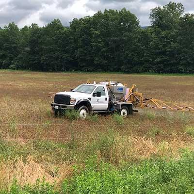 A white truck in a field.