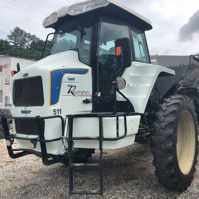 A white Rockingham Coop tractor.