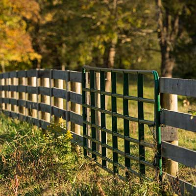 A wooden fence in a field.