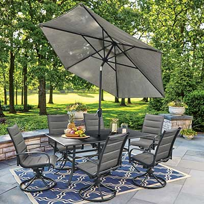 An outdoor patio set with an umbrella.