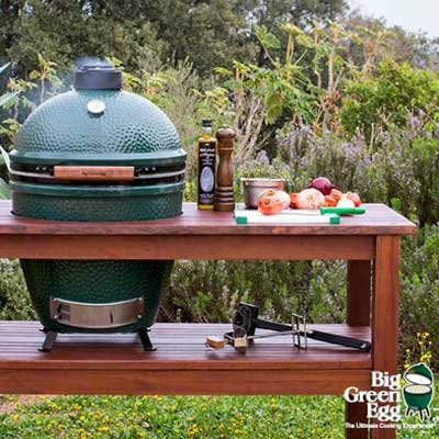 A green egg shaped grill.