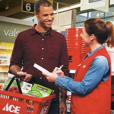An ACE employee helping a customer while he shops around.