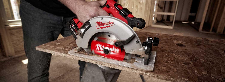 A circular saw cutting some wood.