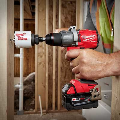 A power drill going into a 2x4.