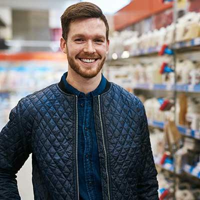 A man posing as he shops the store.