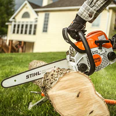 A chainsaw cutting into wood.