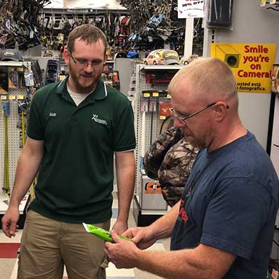 A Rockingham Coop employee helping a customer.